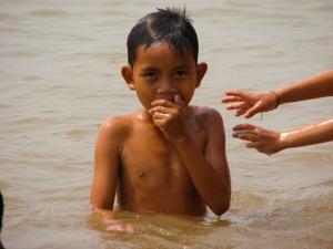 child-at-play-water-closeup